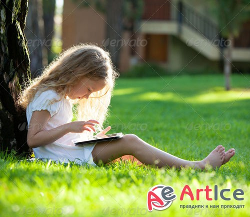 PhotoDune Child with tablet pc outdoors 6694402